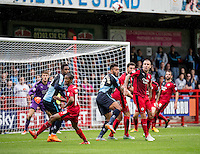 Jimmy Smith of Crawley Town clears the danger during the Sky Bet League 2 match between Crawley Town and Wycombe Wanderers at Checkatrade.com Stadium, Crawley, England on 29 August 2015. Photo by Liam McAvoy.