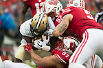 Wisconsin Badgers teammates Alec James (57), T.J. Edwards (53) and Garret Dooley (5) make a tackle during an NCAA College Football Big Ten Conference game against the Purdue Boilermakers Saturday, October 14, 2017, in Madison, Wis. The Badgers won 17-9. (Photo by David Stluka)