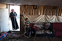 A family from Abu Nowar Bedouin community.  Already served demolition orders, the 118-person community bides time, squeezed between Ma'aleh Adumim on one side and a military base on the other.