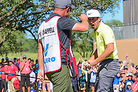 Kevin Chappell (USA) and caddie Joe Greiner after sinking his birdie putt on 18 to win the 2017 Valero Texas Open, AT&amp;T Oaks Course, TPC San Antonio, San Antonio, Texas, USA. 4/23/2017.<br /> Picture: Golffile | Ken Murray<br /> <br /> <br /> All photo usage must carry mandatory copyright credit (&copy; Golffile | Ken Murray)