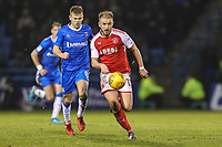 Paddy Madden of Fleetwood Town under pressure from Jake Hessenthaler of Gillingham during the Sky Bet League 1 match between Gillingham and Fleetwood Town at the MEMS Priestfield Stadium, Gillingham, England on 27 January 2018. Photo by David Horn.