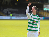 17th March 2019, Dens Park, Dundee, Scotland; Ladbrokes Premiership football, Dundee versus Celtic; Mikael Lustig of Celtic celebrates with a raised fist to the Celtic supporters