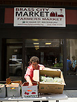 WATERBURY, CT - 23 July 2015-072315EC02-- Sue Pronovost puts fresh vegetables in boxes outside of the Brass City Harvest headquarters along Bank Street in downtown Waterbury Thursday. Erin Covey Republican-American.