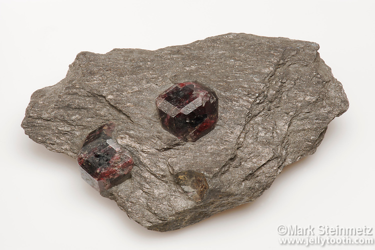 Almandine garnet crystals in a matrix of schist. Strickeen River, Alaska, USA.