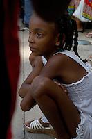 girl watching street performance,  Havana, Cuba
