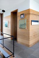 hallway with wood paneling wall