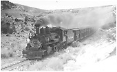 D&amp;RGW K-27 #452 westbound climbing Cerro Summit with a stock train.<br /> D&amp;RGW  Cerro Summit, CO  Taken by Perry, Otto C. - 11/26/1942