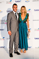 SURFERS PARADISE, Queensland/Australia (Friday, March 1, 2013) Joel Parkinson (AUS) and wife Monica Parkinson (AUS)- The world's best surfers congregated last night at the QT Hotel in Surfers Paradise to celebrate the 2013 ASP World Surfing Awards, officially crowning last year's ASP World Champions and welcoming in the new year..Joel Parkinson (AUS), 31, long considered to be a threat to the ASP World Title ever since his inception amongst the world's elite over a decade ago, was awarded his maiden crown last night. Amidst a capacity crowd of the world's best surfers and hometown supporters, the Gold Coast stalwart brought the house down with a heartfelt and emotional speech..?It's beautiful to have everyone here tonight,? Parkinson said. ?We all come together and really celebrate last season amongst our friends and family. The new year, for me, begins tomorrow. Tonight, I just feel so fortunate to be up here and to be supported by my beautiful family. I love them and am only here because of them.?.FULL LIST OF AWARDS' RECIPIENTS:.2012 ASP World Champion: Joel Parkinson (AUS).2012 ASP World Runner-Up: Kelly Slater (USA).2012 ASP Rookie of the Year: John John Florence (HAW).2012 ASP Women's World Champion: Stephanie Gilmore (AUS).2012 ASP Women's World Runner-up: Sally Fitzgibbons (AUS).2012 ASP Women's Rookie of the Year: Malia Manuel (HAW).2012 ASP Breakthrough Performer: Sebastian Zietz (HAW).2012 ASP Women's Breakthrough Performer: Lakey Peterson (USA).2012 ASP World Longboard Champion: Taylor Jensen (USA).2012 ASP Women's World Longboard Champion: Kelia Moniz (HAW).2012 ASP World Junior Champion: Jack Freestone (AUS).2012 ASP Women's World Junior Champion: Nikki Van Dijk (AUS).ASP Life Member/Chairman Emeritus: Richard Grellman.ASP Service to the Sport: Randy Rarick.Peter Whittaker Award: Adrian Buchan.2012 ASP Men's Heat of the Year (Fan Vote): Mick Fanning (AUS) vs. Kelly Slater (USA) - Rip Curl Pro Bells Beach.2012 ASP Women's Heat of the Year (Fan Vote): La