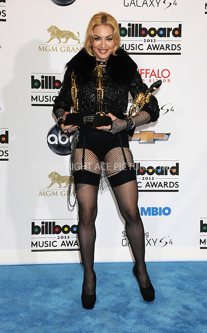 WWW.ACEPIXS.COM....US Sales Only....May 19 2013, Las Vegas....Madonna in the press room at the 2013 Billboard Music Awards held at the MGM Hotel and Casino on May 19 2013 in Las Vegas ....By Line: Famous/ACE Pictures......ACE Pictures, Inc...tel: 646 769 0430..Email: info@acepixs.com..www.acepixs.com