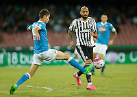 Juventus' Simone Zaza  is challenged by Napoli's Jorginho   during the  italian serie a soccer match     at  the San  Paolo   stadium in Naples  Italy , September 26 , 2015