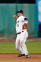 D.J. Peterson #33 of the Everett AquaSox makes a throw during a game against the Tri-City Dust Devils at Everett Memorial Stadium on July 23, 2013 in Everett, Washington. Everett defeated Tri-City, 3-2. (Larry Goren/Four Seam Images)