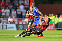 Callum Wilson of AFC Bournemouth gets a poke in the face from Wes Morgan of Leicester City during AFC Bournemouth vs Leicester City, Premier League Football at the Vitality Stadium on 15th September 2018