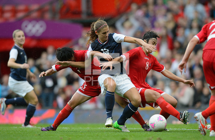 Manchester, England - July 31, 2012: The USA Women's soccer team 1-0 over North Korea during the opening round of the Olympic football tournament at Old Trafford. Alex Morgan battles for the ball.