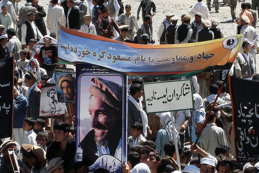 AFGHANISTAN, PANJSHIR PROVINCE, PANJSHIR VALLEY, TOMB OF COMMANDER AHMAD SHAH MASSOUD - 10/09/2007. Commemoration for Commander Ahmad Shah Massoud's assassination. The mujahideen's tribute to Massoud.Banners and panels with Reza's famous photograph of Commander Ahmad Shah Massoud.<br /> <br /> AFGHANISTAN, PROVINCE DU PANJSHIR, VALLE DU PANJSHIR, TOMBEAU DU COMMANDANT AHMAD SHAH MASSOUD - 10/09/2007. Commemorations pour l'assassinat du Commandant Ahmad Shah Massoud. L'hommage des mujahideen. Bannieres et panneau avec la celebre photographie du Commandant Ahmad Shah Massoud prise par Reza.