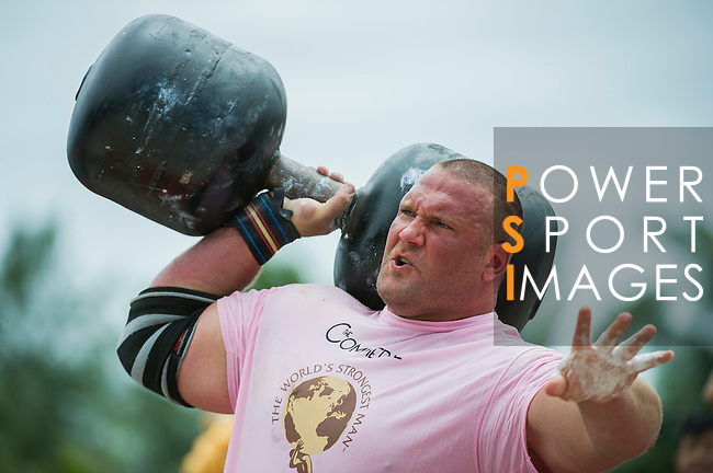 HAINAN ISLAND, CHINA - AUGUST 24:  Terry Hollands of United Kingdom competes at the Circus Medley event during the World's Strongest Man competition at Yalong Bay Cultural Square on August 24, 2013 in Hainan Island, China.  Photo by Victor Fraile