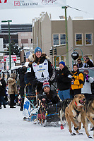 Anna Berington and team leave the ceremonial start line with an Iditarider and handler at 4th Avenue and D street in downtown Anchorage, Alaska on Saturday March 3rd during the 2018 Iditarod race. Photo ©2018 by Brendan Smith/SchultzPhoto.com