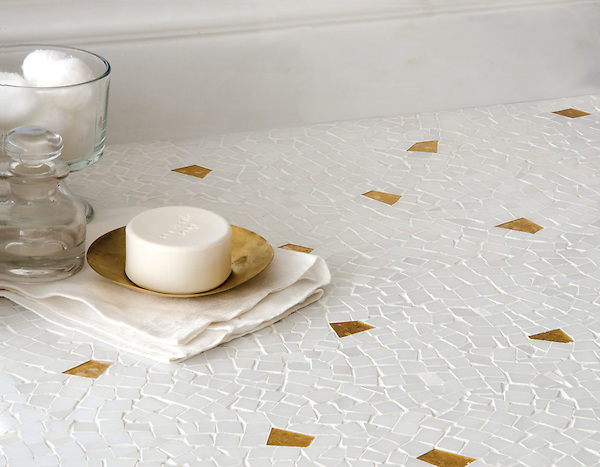 Cosmos, a handmade mosaic shown in polished Afyon White with 24K Gold Glass, is part of the Aurora&reg; collection by Sara Baldwin for New Ravenna.<br />