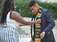 Graduating seniors, faculty and staff gather for the Black Graduation Celebration, on the  steps between Johnson and Fowler Halls on Saturday, May 18, 2019.<br /> <br /> (Photo by John Valenzuela, Freelance Photographer)