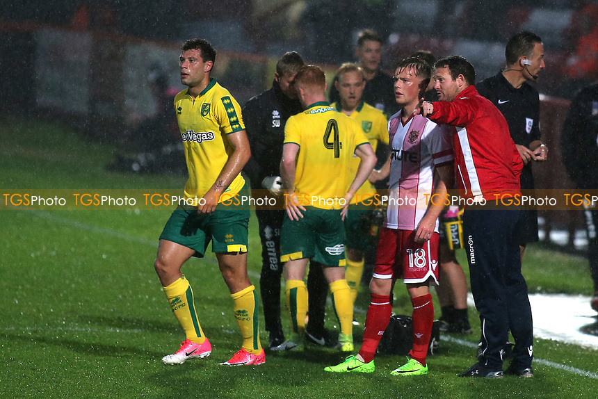 Stevenage Manager, Darren Sarll, gives a bit of advice to Tom Conlon while Norwich City's Harrison Reed receives treatment for an injury during Stevenage vs Norwich City, Friendly Match Football at the Lamex Stadium on 11th July 2017