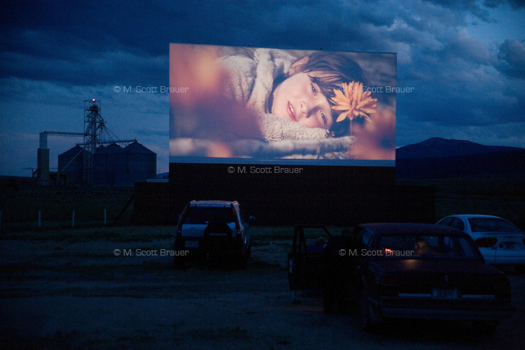 Movies show on a drive-in movie theater screen outside of Butte, Montana, USA.