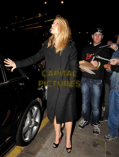 CLAIRE DANES.Arriving at Notting Hill cinema for a Q & A session for her new film 'Me & Orson Welles', London, England..November 18th, 2009.Q&A full length car black coat jacket clare hand in pocket looking up peep toe shoes profile .CAP/IA.©Ian Allis/Capital Pictures.