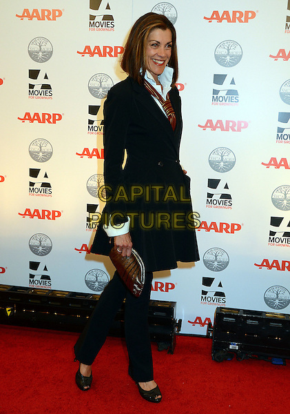 Wendie Malick.AARP Magazine's 11th Annual Movies For Grownups Awards Gala held at the Beverly Wilshire Four Seasons Hotel, Beverly Hills, California, USA..February 6th, 2012.full length black jacket trousers tie clutch bag.CAP/ADM/BT.©Birdie Thompson/AdMedia/Capital Pictures.