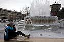A girl take picture of a frozen fountain, Milan, February 5, 2012. In the background the Sforza's Castle.Italy is hit by an atmospheric disturbance of Siberian origin. © Carlo Cerchioli..Una ragazza fa fotografie della fontana ghicciata di piazza castello a Milano, 5 febbraio 2012. Sullo sfondo una toree del  Castello Sforzesco. L'Italia è colpita da una perturbazione atmosferica di origine siberiana.