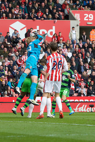 02.04.2016. Britannia Stadium, Stoke, England. Barclays Premier League. Stoke City versus Swansea City.  Stoke City goalkeeper Jakob Haugaard grasps the ball from a cross