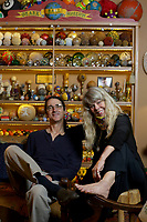 Kelly and Donna Muhollan, who are the folk music duo Still on the Hill, Friday, May 15, 2020, in the living room of their home in Fayetteville that also doubles as the Ozark Ball Museum. Check out nwaonline.com/200524Daily/ and nwadg.com/photos for a photo gallery.<br /> (NWA Democrat-Gazette/David Gottschalk)