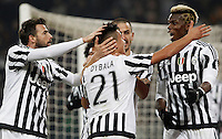 Juventus' Paulo Dybala, back to camera, celebrates with teammates Andrea Barzagli, left, Leonardo Bonucci and Paul Pogba, right, after scoring the winning goal during the Italian Serie A football match between Juventus and Roma at Juventus Stadium. Juventus won 1-0.