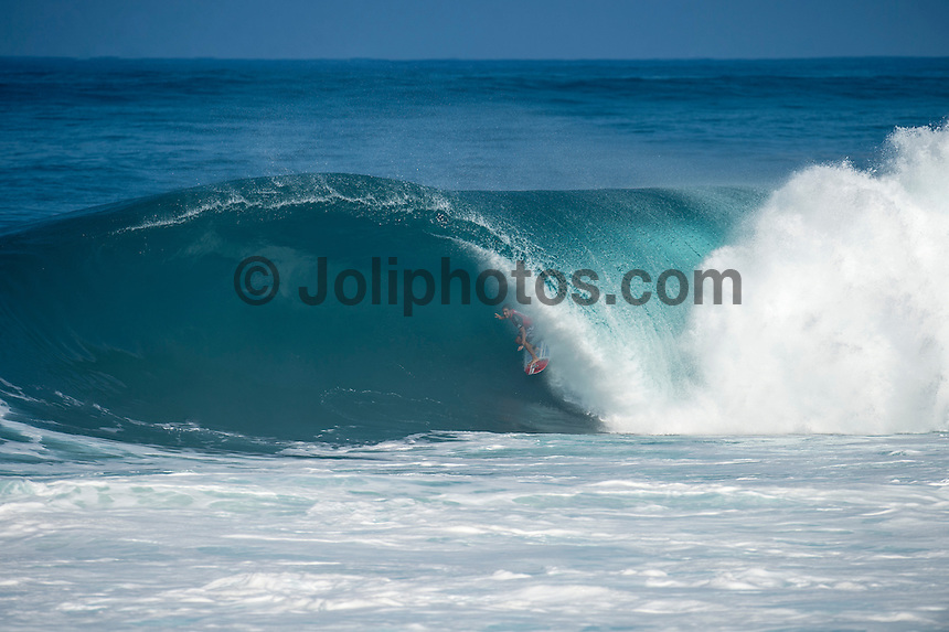 BANZAI PIPELINE, Oahu/Hawaii (Tuesday, December 9, 2014) Joel Centeio (HAW) scoring the perfect 10 point wave. - The final stop of the 2014  World Championship Tour, the Billabong Pipe Masters in Memory of Andy Irons, was been called ON today in double- to triple-overhead surf. <br /> <br /> Competition began with the Men's Pipe Masters Invitational. A 32-man event comprised of local Pipe specialists competing for a US$100,000 prize purse as well as two wildcard positions in the Billabong Pipe Masters. <br /> The Billabong Pipe Masters in Memory of Andy Irons will determine this year&rsquo;s world surfing champion as well as those who qualify for the elite tour in 2015. As the third and final stop on the Vans Triple Crown of Surfing Series  the event will also determine the winner of the revered three-event leg.<br /> <br /> The ASP Heritage Series, which celebrates the rich culture and history of professional surfing, is poised to have its third and final competitive event of the season with a four-man heat between Gary Elkerton (AUS), Tom Carroll (AUS), Derek Ho (HAW) and Sunny Garcia (HAW).<br /> <br /> The world&rsquo;s best female surfers will also compete at Pipeline this year in the Women&rsquo;s Pipe Masters Invitational with reigning six-time  Women&rsquo;s World Champion Stephanie Gilmore (AUS), two-time Women&rsquo;s World Champion Carissa Moore (HAW), Australian powerhouse Tyler Wright (AUS) and international icon Bethany Hamilton (HAW) battling it out at the world-famous Pipeline. Photo: joliphotos.com