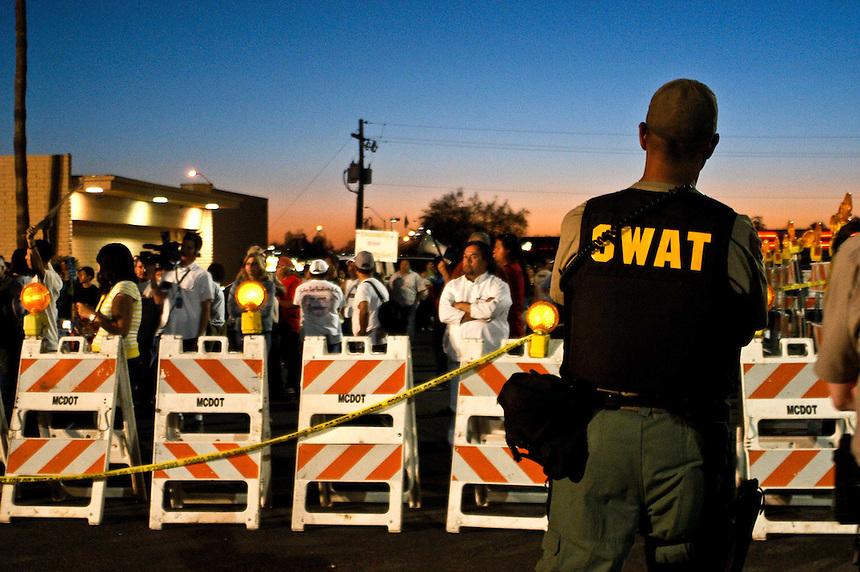 AJ Alexander - Sheriff Joe Arpaio's MCSO Deputy Sheriff Swat Officedr over looks protesters in Phoenix, Arizona.<br /> Photo by AJ Alexander