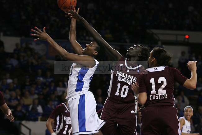 UK senior forward Brittany Henderson soars past Mississippi State at Memorial Coliseum on Thursday, January 17, 2013 in Lexington, Ky.  Photo by Adam Pennavaria | Staff