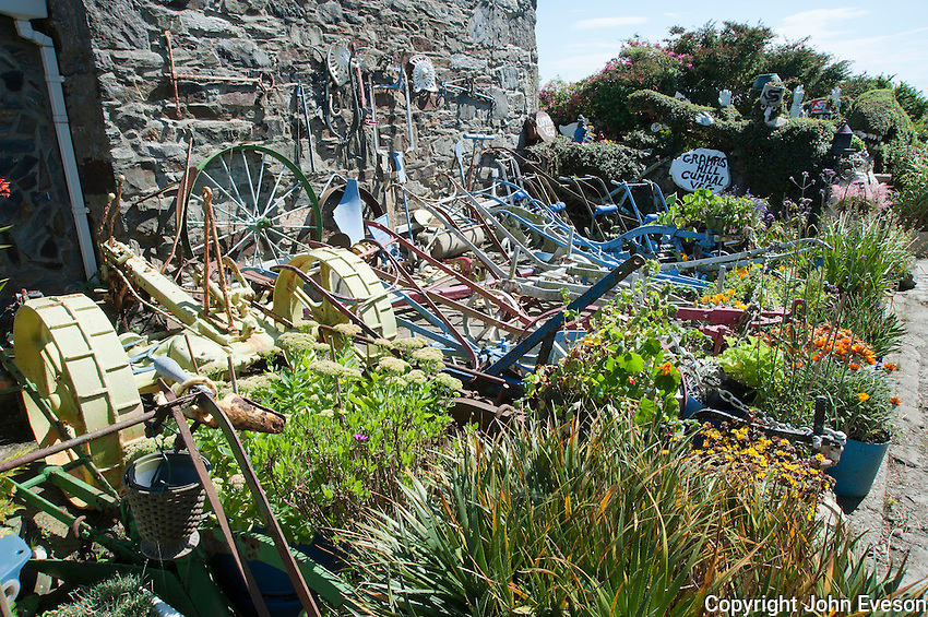 Garden with old farm machinery, Rushen, Isle of Man.