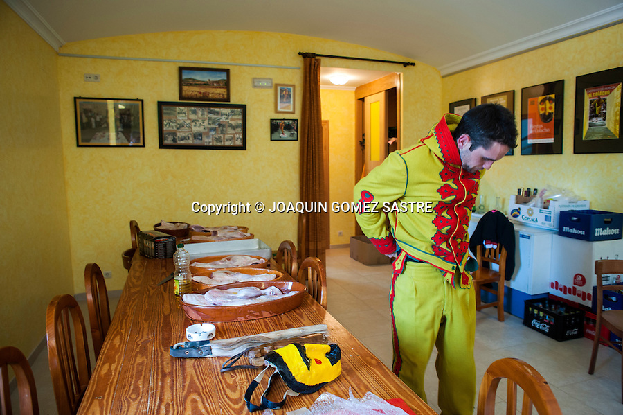 The young man who plays colacho is prepared before heading out on the streets of the town Castrillo of Murcia in Burgos