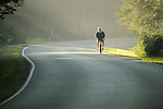 Rob Beidelspocker cycling on misty Fall morning.