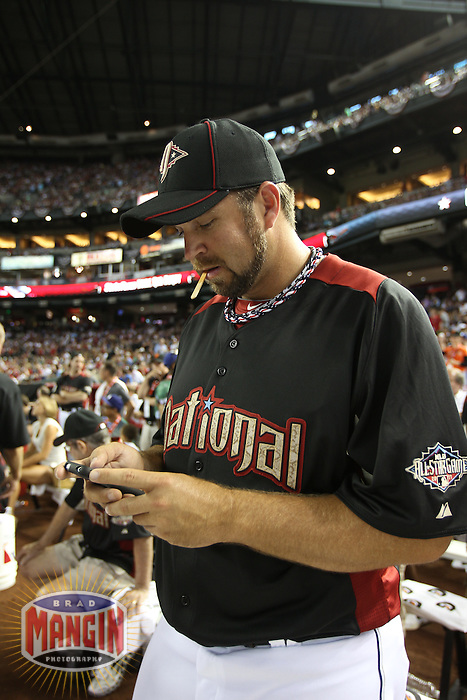 PHOENIX - JULY 11:  Heath Bell Tweets during the 2011 MLB Home Run Derby at Chase Field on July 11, 2011 in Phoenix, Arizona. Photo by Brad Mangin