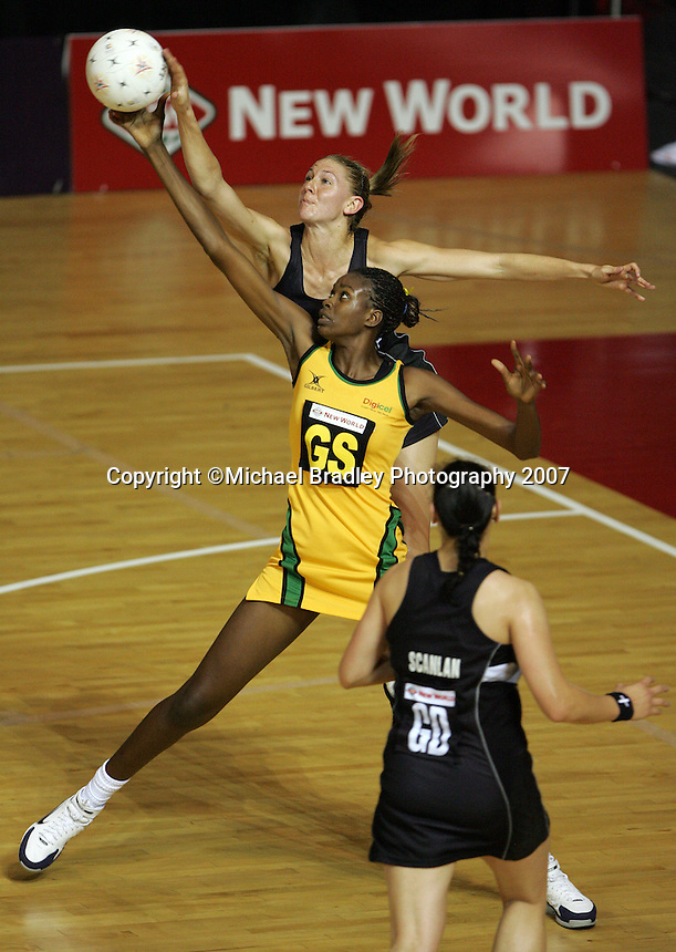 16.11.2007 Silver Ferns Casey Williams and Jamaica's Romelda Aiken in action during the Silver Ferns v Jamaica match at the New World Netball World Champs held at Trusts Stadium Auckland New Zealand. Mandatory Photo Credit ©Michael Bradley.