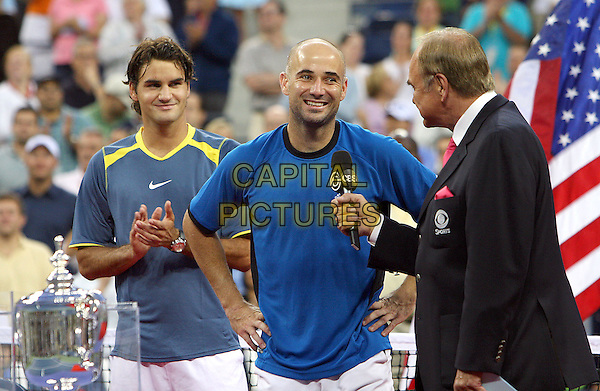 ROGER FEDERER & ANDRE AGASSI .Atmosphere before 2005 US Open Tennis Men's Championship starts, Flushing, NY. .September 11th, 2005.Photo Credit Jackson Lee/Admedia.half length blue shirt interview.www.capitalpictures.com.sales@capitalpictures.com.© Capital Pictures.