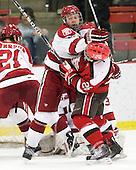 Brendan Rempel (Harvard - 42), Kyle Essery (St. Lawrence - 26) - The Harvard University Crimson defeated the St. Lawrence University Saints 4-3 on senior night Saturday, February 26, 2011, at Bright Hockey Center in Cambridge, Massachusetts.