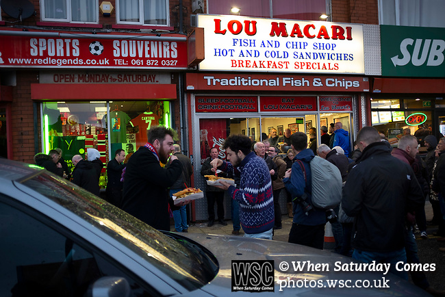 Manchester United 0, Manchester City 2, 24/04/2019. Old Trafford Stadium, English Premier League. Fans congregating outside fast food outlets before Manchester United hosted Manchester City at Old Trafford. This was the 178th time the sides had met, with City looking to overtake rivals Liverpool in the race for the English Premier League title. City won the match 2-0 watched by 74,431 spectators. Photo by Colin McPherson.