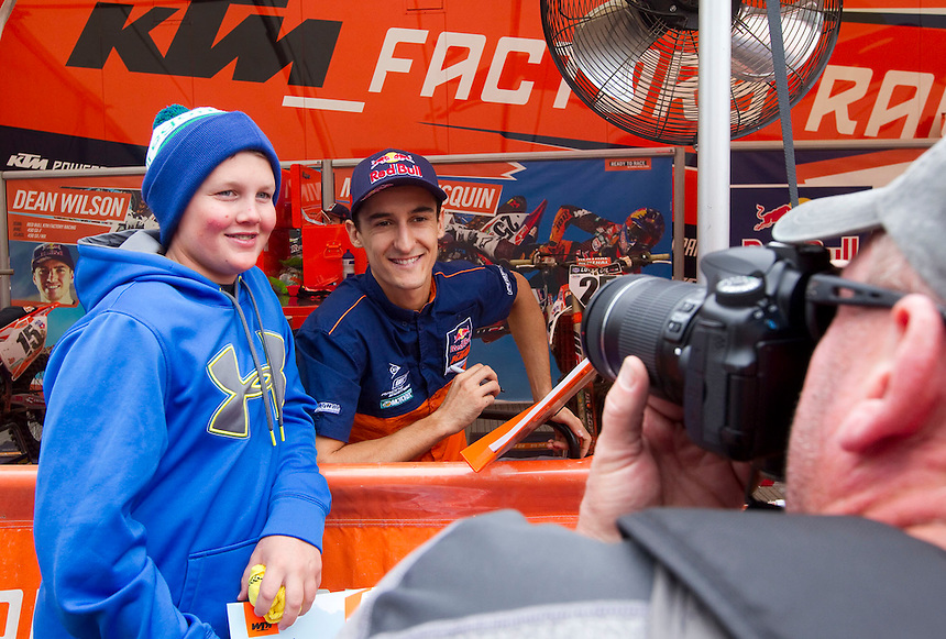 Motocross rider Marvin Musquin poses with Ryker McGrath at the Washougal MX National in Washougal Saturday July 23, 2016. D(Photo by Natalie Behring/ for the The Columbian)
