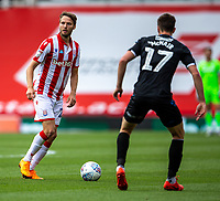 27th June 2020; Bet365 Stadium, Stoke, Staffordshire, England; English Championship Football, Stoke City versus Middlesbrough; Nick Powell of Stoke City looks to cross the ball past Paddy McNair of Middlesbrough
