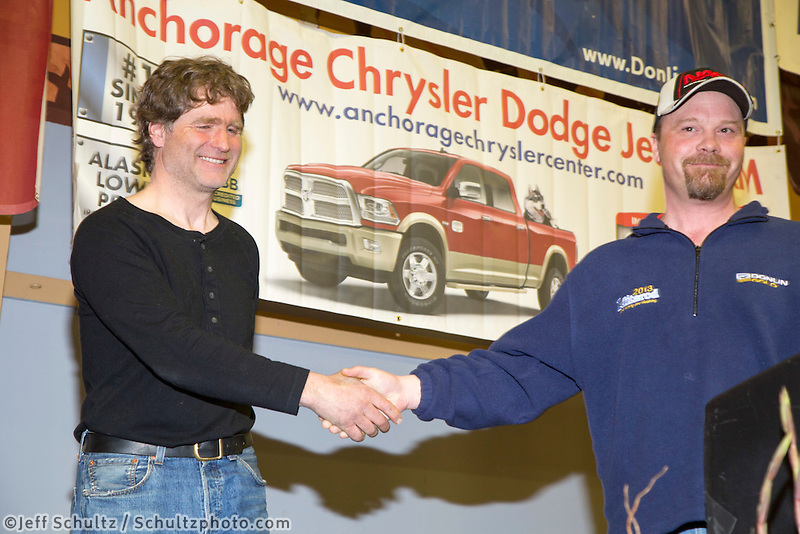 The Jerry Austin Memorial Rookie of the Year award is<br /> presented by Aaron Burmeister, ITC board member<br /> to Geir Idar Hjelvik at the musher finisher's banquet in Nome during the 2016 Iditarod.  Alaska    <br /> <br /> Photo by Jeff Schultz (C) 2016  ALL RIGHTS RESERVED