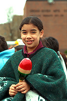 Participant age 12 holding maraca at Cinco de Mayo parade.  St Paul Minnesota USA