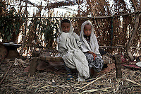 Ambaun, 9 years old, on left and Deghe, 7 years old, on right sit in their matrimonial tent before their wedding celebration commence   in a village in Northern Amhara region on February 16, 2009 in Ethiopia..While in decline, early child marriage is still widely spread in rural areas of Ethiopia where families sell their daughters into marriage at ages as young as 5 years old...Names of subjects have been fictionalized and specific locations have been omitted to protect the identities of the children portrayed in the story.