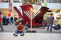 Multicultural holiday display in the Queens Center mall in the borough of Queens in New York on Super Saturday, December 20, 2014. Super Saturday, the Saturday prior to Christmas was crowded with shoppers and is expected to generate more sales than Black Friday.  (© Richard B. Levine)