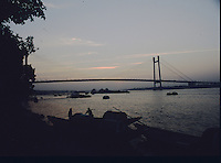 Boatmen dock their boats at Princep Ghat as the sun sets on The Hooghly