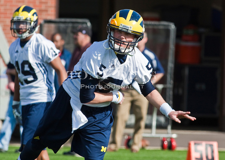 Michigan quarterback Tate Forcier (5) watches a pass he threw on the first day of spring football practices, Tuesday, March 16, 2010, in Ann Arbor, Mich. (AP Photo/Tony Ding)