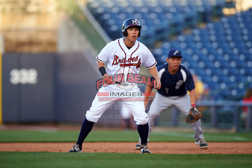 Mississippi Braves outfielder KD Kang (12) leads off first during a game against the Pensacola Blue Wahoos on May 27, 2015 at Trustmark Park in Pearl, Mississippi.  Pensacola defeated Mississippi 7-5 in fourteen innings.  (Mike Janes/Four Seam Images)